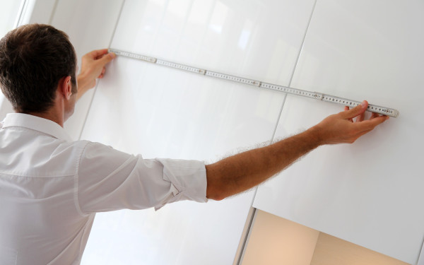 Taking measurements during kitchen remodel