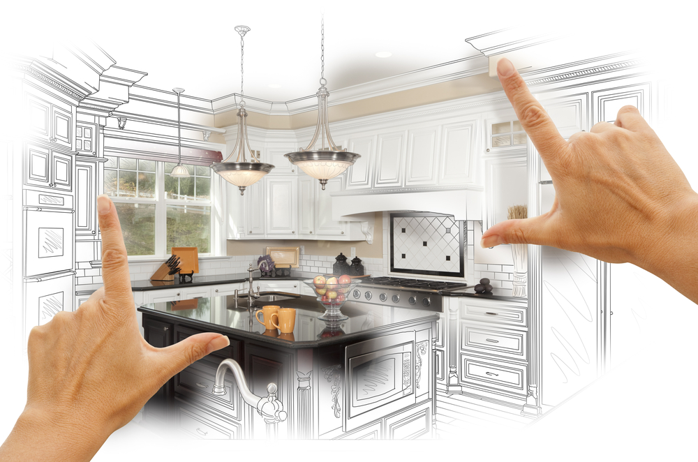 bigstock_83103200_Female-Hands-Framing-Custom-Kitchen-Design-Drawing-and-Photo-Combination.