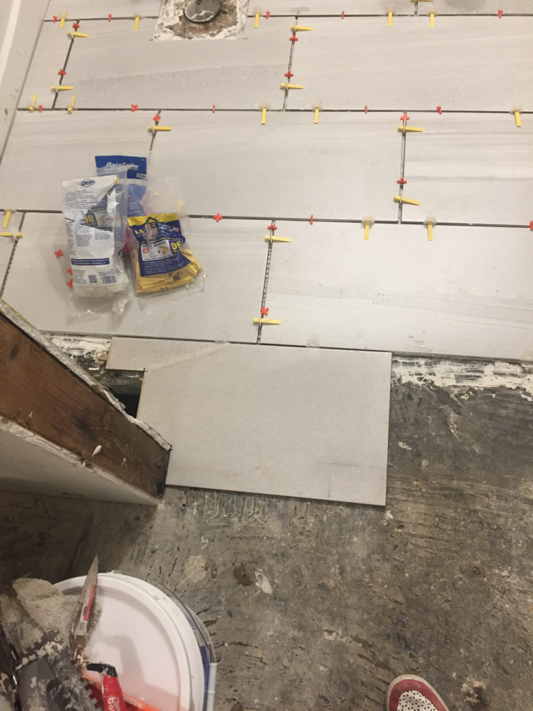 laying floor tile
