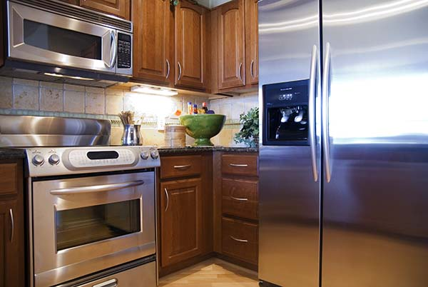 a beautiful bright modern kitchen with stainless steel appliances