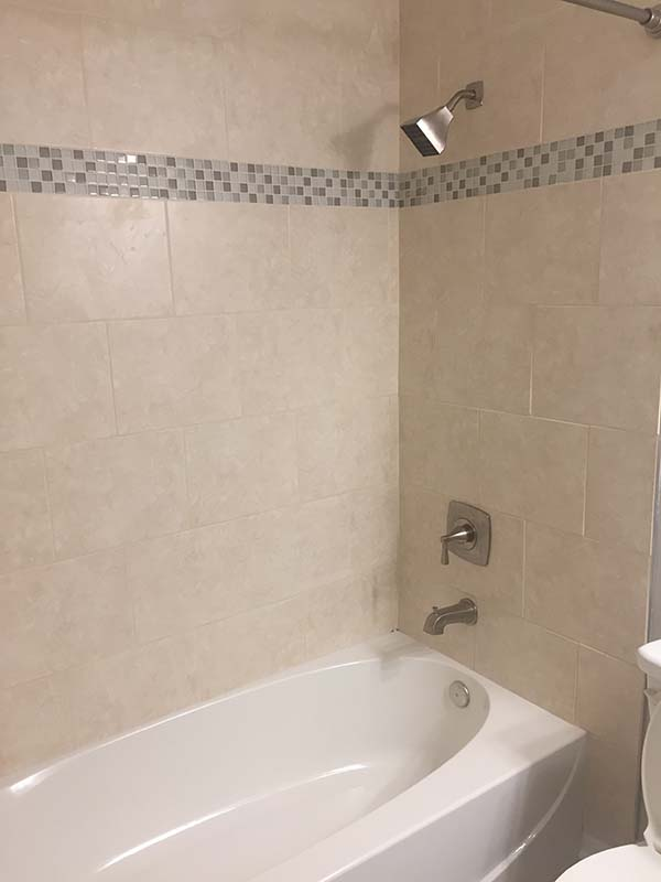 Ivory Tile with 1x1 mosaic tile shower louisville cincinnati